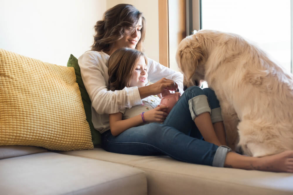 dog with her human family at home